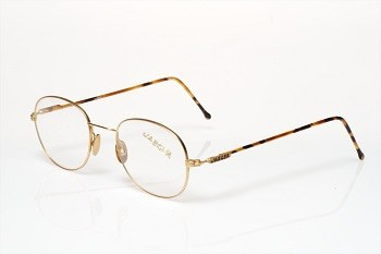 "Jaeger 104: Fine uni-sex gold titanium frame with full length ""tortoise"" temples."